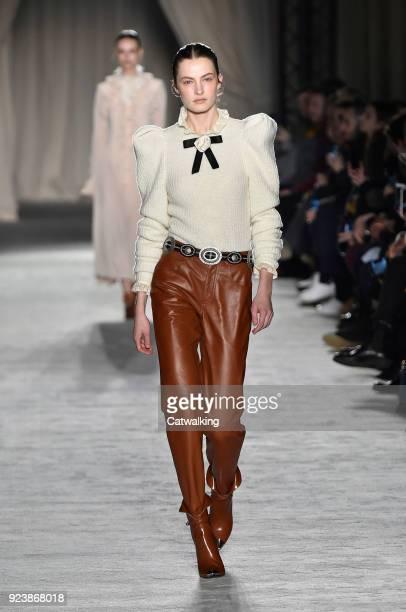A model walks the runway at the Philosophy di Lorenzo Serafini Autumn Winter 2018 fashion show during Milan Fashion Week on February 24 2018 in Milan...