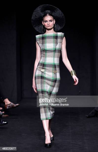 A model walks the runway at the Phoenix Keating show during MercedesBenz Fashion Week Australia 2014 at Carriageworks on April 7 2014 in Sydney...