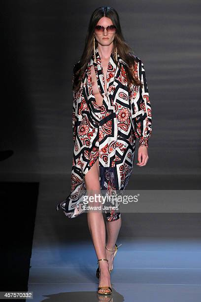 A model walks the runway at the Pink Tartan Spring/Summer 2015 fashion show during World Mastercard Fashion Week on October 20 2014 in Toronto Canada