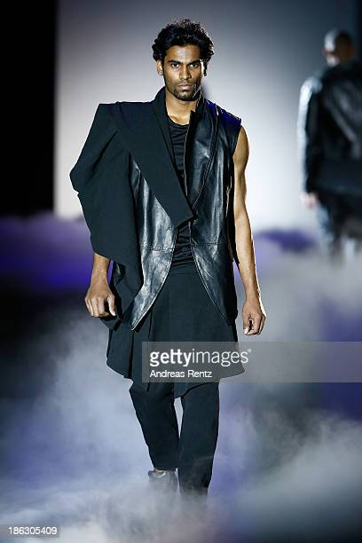 A model walks the runway at the PIROSMANI BY JENYA MALYGINA show during MercedesBenz Fashion Week Russia S/S 2014 on October 30 2013 in Moscow Russia