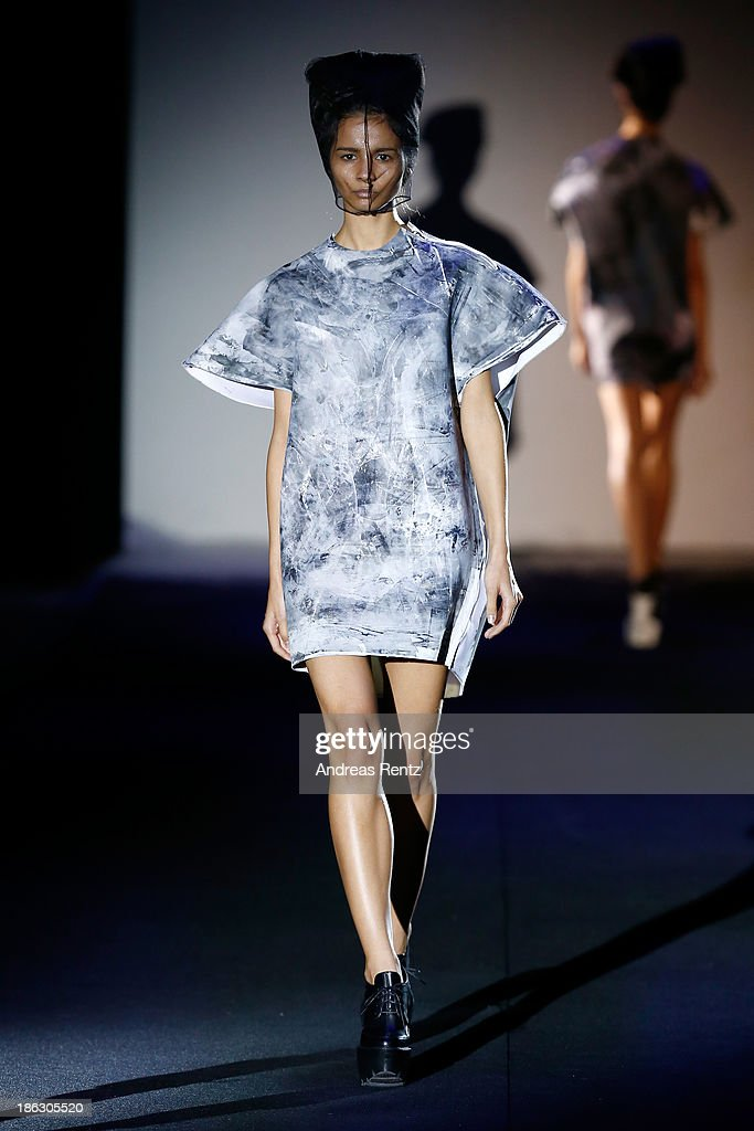 A model walks the runway at the PIROSMANI BY JENYA MALYGINA show during Mercedes-Benz Fashion Week Russia S/S 2014 on October 30, 2013 in Moscow, Russia.