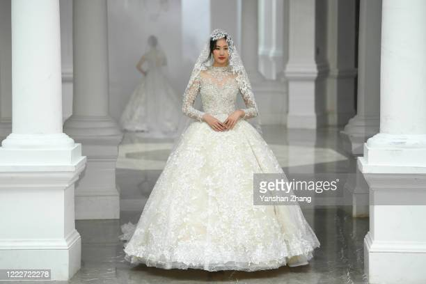Model walks the runway at the PJ+ collection show during the China Fashion Week 2020/2021 A/W Collection on May 04, 2020 in Beijing, China. Affected...