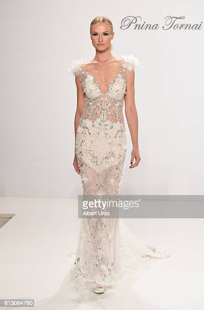 A model walks the runway at the Pnina Tornai For Kleinfeld show during New York Fashion Week Bridal at Kleinfeld on October 6 2016 in New York City