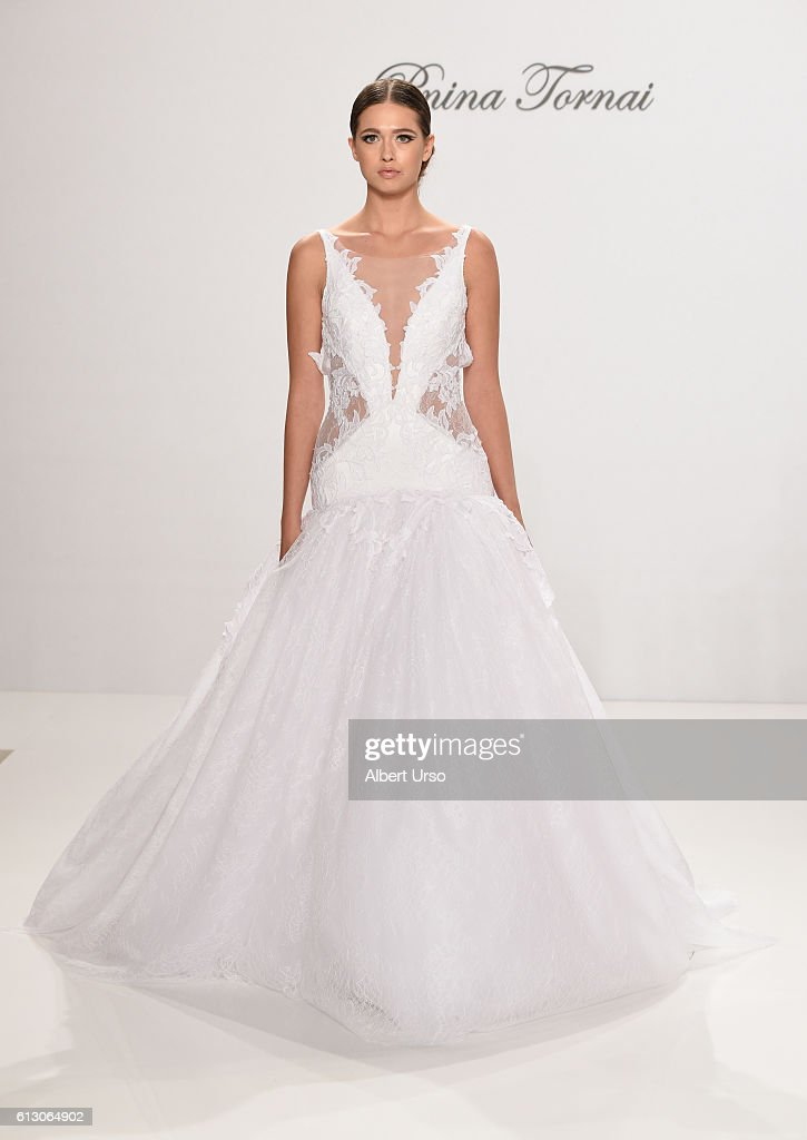A model walks the runway at the Pnina Tornai For Kleinfeld show during New York Fashion Week: Bridal at Kleinfeld on October 6, 2016 in New York City.