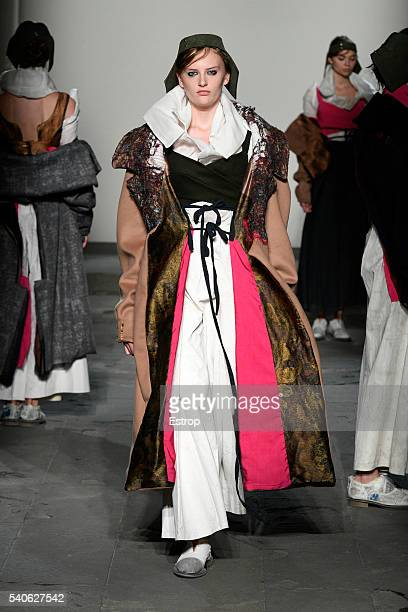 A model walks the runway at the Polimoda fashion show designed by Aysegul Yazicioglu during Pitti 90 on June 14 2016 in Florence Italy