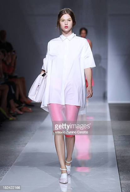 Model walks the runway at the Ports 1961 Spring/Summer 2013 fashion show as part of Milan Womenswear Fashion Week on September 20, 2012 in Milan,...