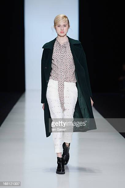 A model walks the runway at the Poustovit show during MercedesBenz Fashion Week Russia Fall/Winter 2013/2014 at Manege on March 31 2013 in Moscow...