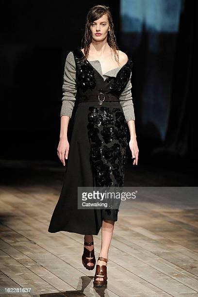 Model walks the runway at the Prada Autumn Winter 2013 fashion show during Milan Fashion Week on February 21, 2013 in Milan, Italy.