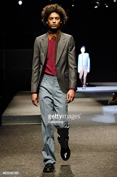 A model walks the runway at the Prada Autumn Winter 2014 fashion show during Milan Menswear Fashion Week on January 12 2014 in Milan Italy