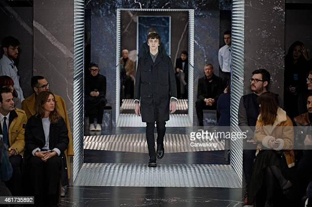 A model walks the runway at the Prada Autumn Winter 2015 fashion show during Milan Menswear Fashion Week on January 18 2015 in Milan Italy