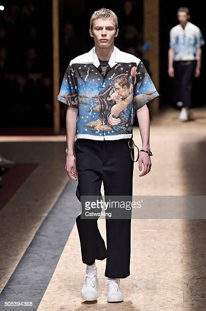 A model walks the runway at the Prada Autumn Winter 2016 fashion show during Milan Menswear Fashion Week on January 17 2016 in Milan Italy