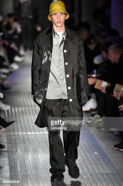 A model walks the runway at the Prada Autumn Winter 2018 fashion show during Milan Menswear Fashion Week on January 14 2018 in Milan Italy