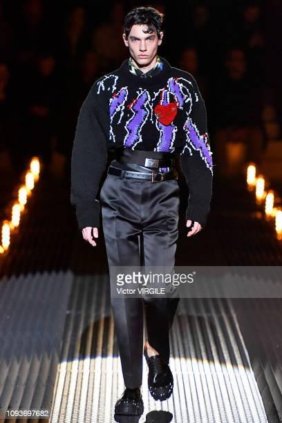 A model walks the runway at the Prada fashion show during Milan Menswear Fashion Week Autumn/Winter 2019/20 on January 13 2019 in Milan Italy