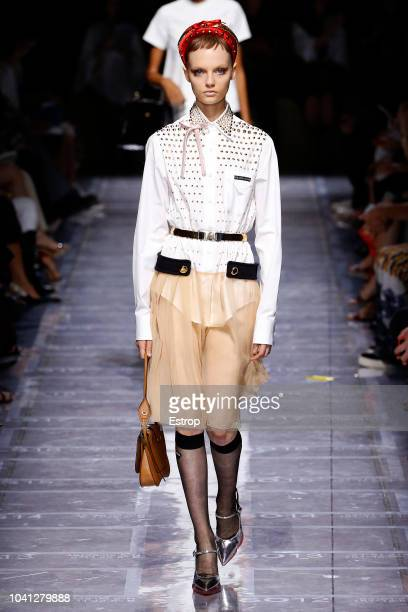 052f4ee9dcb4 A model walks the runway at the Prada show during Milan Fashion Week  Spring Summer