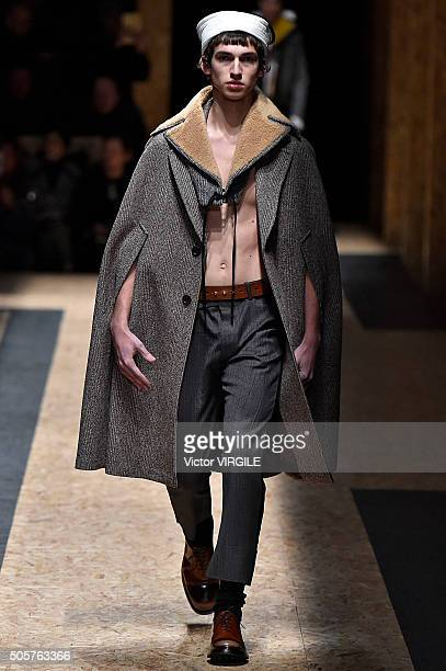 A model walks the runway at the Prada show during Milan Men's Fashion Week Fall/Winter 2016/17 on January 17 2016 in Milan Italy