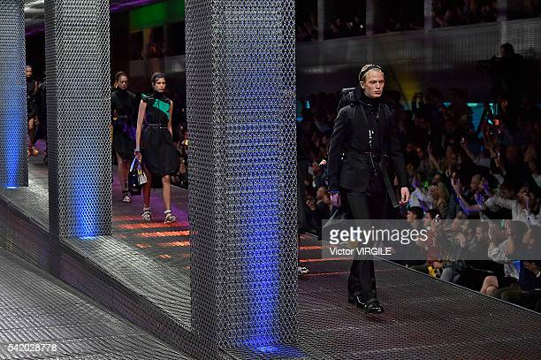A model walks the runway at the Prada show during Milan Men's Fashion Week Spring/Summer 2017 on June 19 2016 in Milan Italy