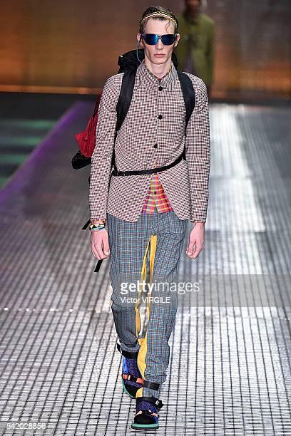A model walks the runway at the Prada show during Milan Men's Fashion Week Spring/Summer 2017 on June 19 2016 in Milan Italy