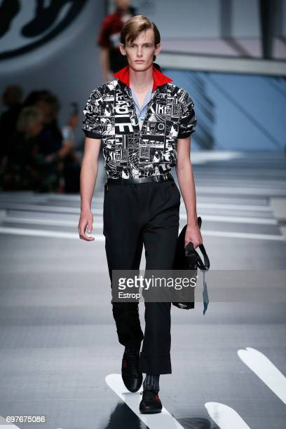 A model walks the runway at the Prada show during Milan Men's Fashion Week Spring/Summer 2018 on June 18 2017 in Milan Italy