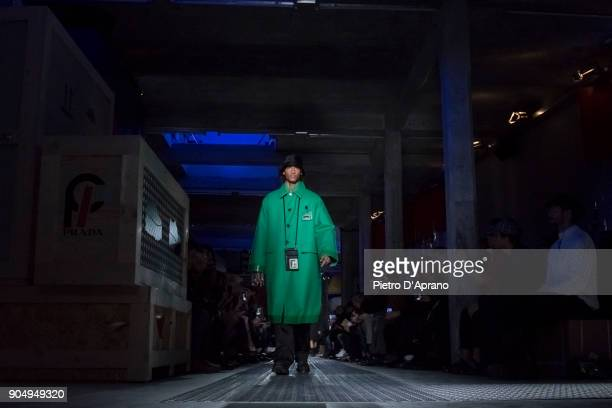 A model walks the runway at the Prada show during Milan Men's Fashion Week Fall/Winter 2018/19 on January 14 2018 in Milan Italy