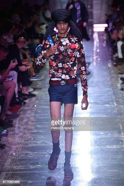 A model walks the runway at the Prada show during Milan Men's Fashion Week Spring/Summer 2019 on June 17 2018 in Milan Italy
