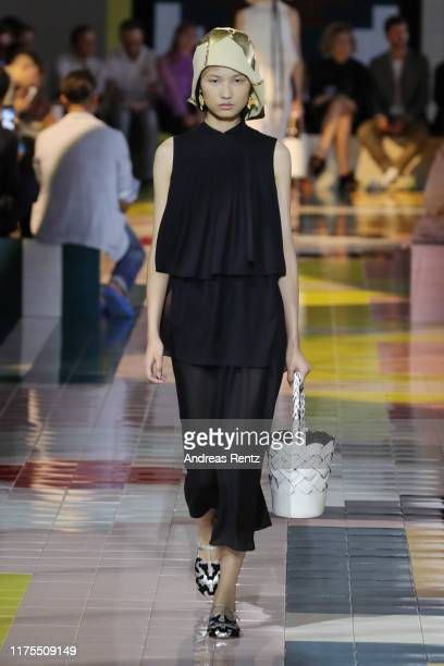 A model walks the runway at the Prada show during the Milan Fashion Week Spring/Summer 2020 on September 18 2019 in Milan Italy