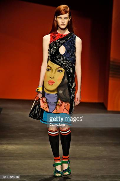 Model walks the runway at the Prada Spring Summer 2014 fashion show during Milan Fashion Week on September 19, 2013 in Milan, Italy.