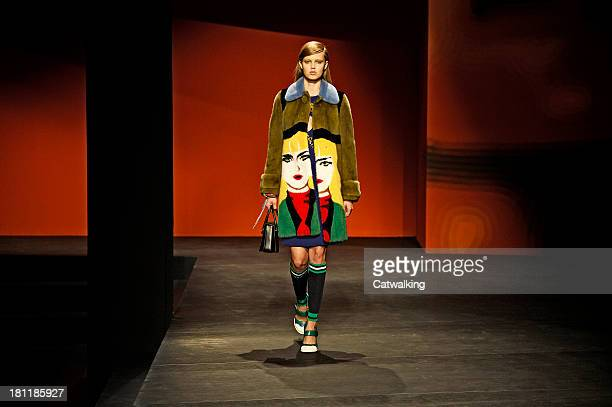 A model walks the runway at the Prada Spring Summer 2014 fashion show during Milan Fashion Week on September 19 2013 in Milan Italy