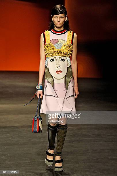 A model walks the runway at the Prada Spring Summer 2014 fashion show during Milan Fashion Week on September 19 2013 in Milan Italy