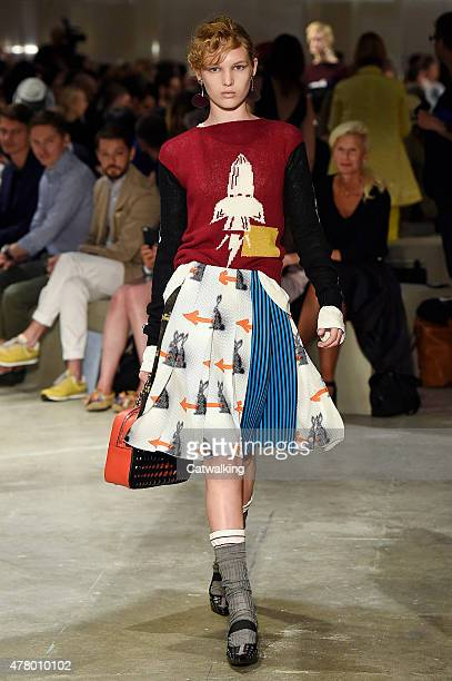 A model walks the runway at the Prada Spring Summer 2016 fashion show during Milan Menswear Fashion Week on June 21 2015 in Milan Italy