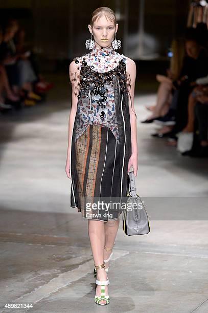A model walks the runway at the Prada Spring Summer 2016 fashion show during Milan Fashion Week on September 24 2015 in Milan Italy