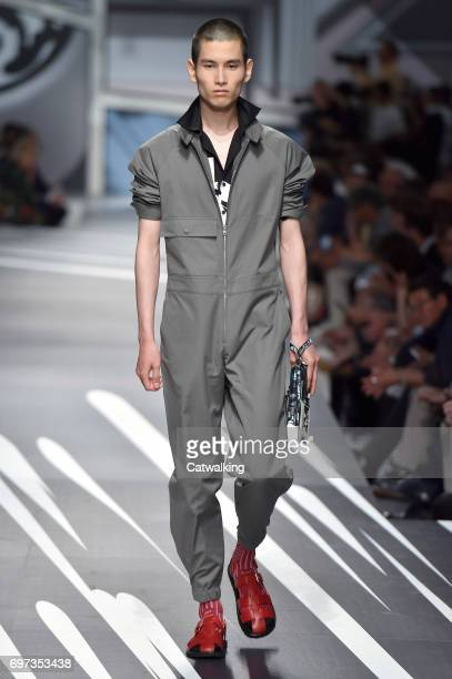 A model walks the runway at the Prada Spring Summer 2018 fashion show during Milan Menswear Fashion Week on June 18 2017 in Milan Italy