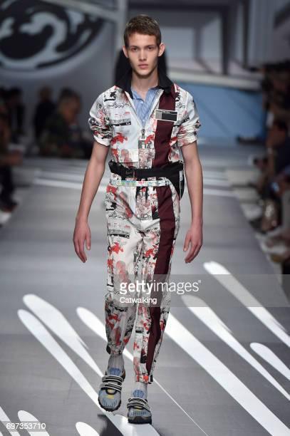 2596347e0edd A model walks the runway at the Prada Spring Summer 2018 fashion show  during Milan Menswear