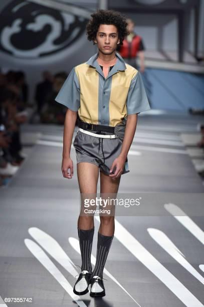 A model walks the runway at the Prada Spring Summer 2018 fashion show during Milan Menswear Fashion Week on June 18 2017 in Milan Italy