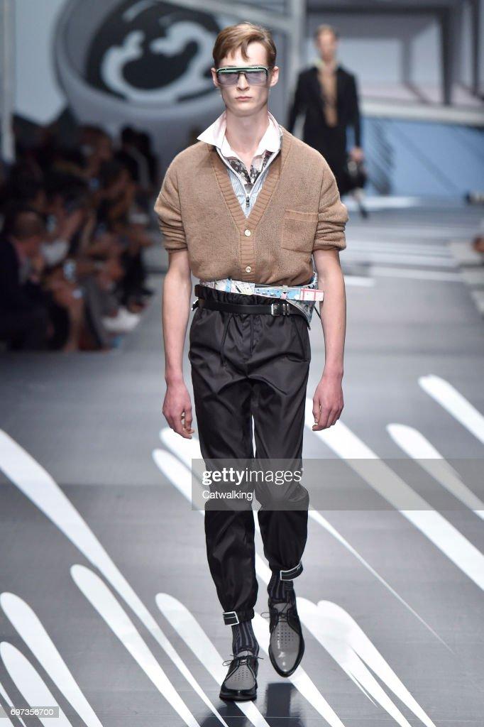 A model walks the runway at the Prada Spring Summer 2018 fashion show during Milan Menswear Fashion Week on June 18, 2017 in Milan, Italy.