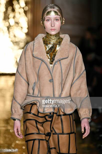 A model walks the runway at the Preen by Thornton Bregazzi Ready to Wear Fall/Winter 20202021 fashion show during London Fashion Week on February 16...
