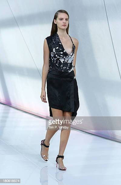 A model walks the runway at the Preen By Thornton Bregazzi show at the Natural History Museum during London Fashion Week SS14 on September 15 2013 in...