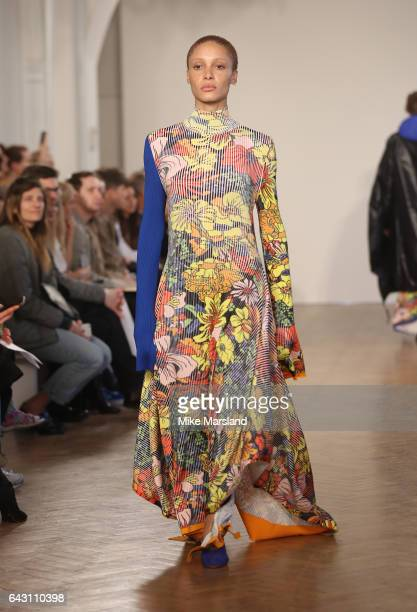 Model walks the runway at the Pringle of Scotland show during the London Fashion Week February 2017 collections on February 20, 2017 in London,...