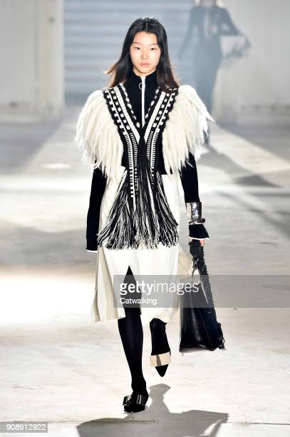 A model walks the runway at the Proenza Schouler Autumn Winter 2018 fashion show during Paris Haute Couture Fashion Week on January 22 2018 in Paris...