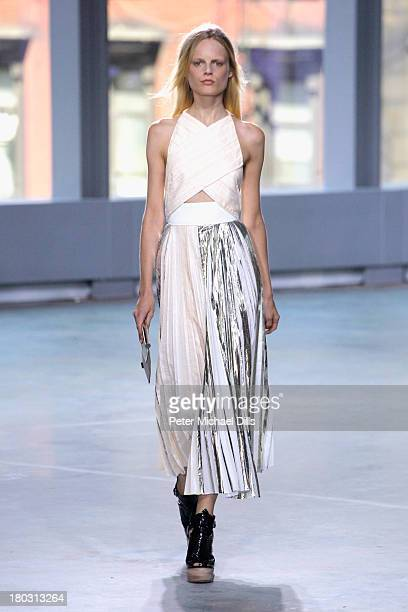 A model walks the runway at the Proenza Schouler fashion show during MercedesBenz Fashion Week Spring 2014 at Skylight Ltd on September 11 2013 in...