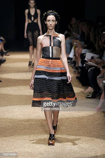 Model walks the runway at the Proenza Schouler Spring 2012 fashion show during Mercedes-Benz Fashion Week at on September 14, 2011 in New York City.