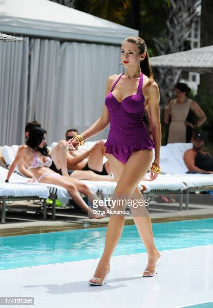 A model walks the runway at the Profile by Gottex show during MercedesBenz Fashion Week Swim 2014 at the SLS Hotel on July 21 2013 in Miami Florida