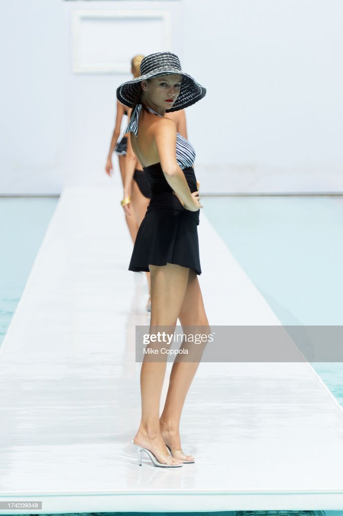 A model walks the runway at the Profile by Gottex show during Mercedes-Benz Fashion Week Swim 2014 at the SLS Hotel on July 21, 2013 in Miami, Florida.