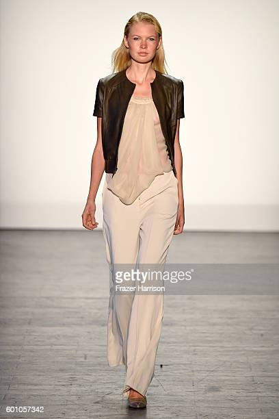 A model walks the runway at the Project Runway fashion show during New York Fashion Week The Shows at The Arc Skylight at Moynihan Station on...