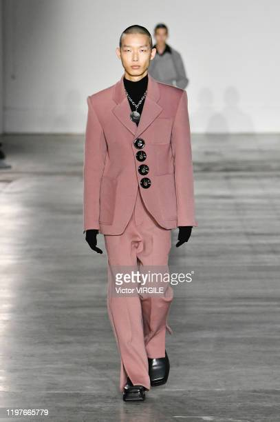 A model walks the runway at the Pronounce Fall/Winter 2020_2021 fashion show during London Fashion Week Men's January 2020 on January 04 2020 in...