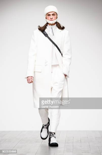 A model walks the runway at the PRONOUNCE Presented By GQ CHINA show during London Fashion Week Men's January 2018 at BFC Show Space on January 8...