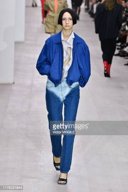 A model walks the runway at the pushBUTTON Ready to Wear Spring/Summer 2020 fashion show during London Fashion Week September 2019 on September 17...