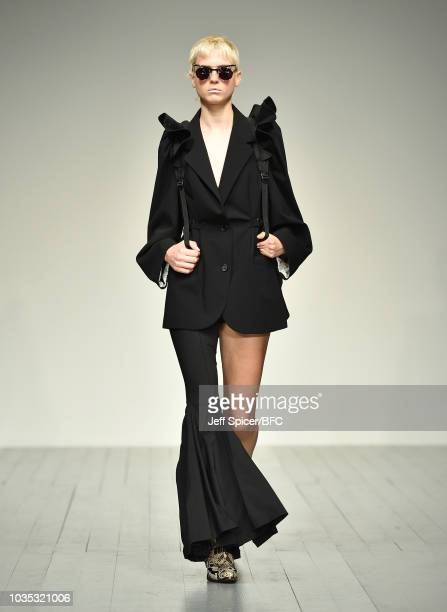 A model walks the runway at the pushBUTTON show during London Fashion Week September 2018 at the BFC Show Space on September 18 2018 in London England