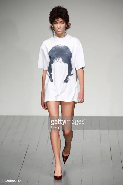 A model walks the runway at the pushBUTTON show during London Fashion Week September 2018 at the BFC Show Space on September 16 2018 in London England