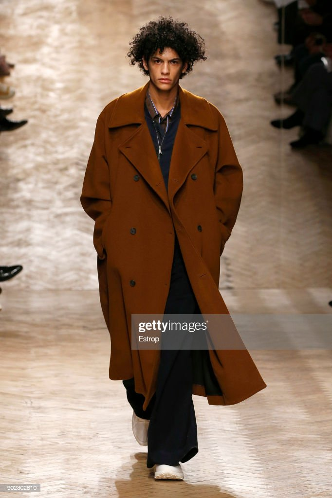 A model walks the runway at the Qasami show during London Fashion Week Men's January 2018 at 100 Sydney Street on January 6, 2018 in London, England.
