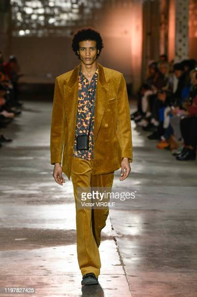 Model walks the runway at the Qasimi Fall/Winter 2020-2021 fashion show during London Fashion Week Men's January 2020 on January 05, 2020 in London,...